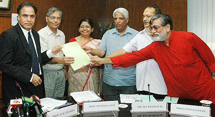 UGC chief S.K. Thorat receiving the report of the �Review the Pay Scales and Service Conditions of University and College Teachers� from its Committee Chairman, Prof. G.K. Chadha, in New Delhi on October 3, 2008.