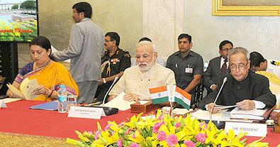 President Pranab Mukherjee, Prime Minister Narendra Modi and HRD Minister Smriti Irani during the Conference of Chairmen, Board of Governors and Directors of Indian Institutes of Technology at Rashtrapati Bhavan in New Delhi on August 22.