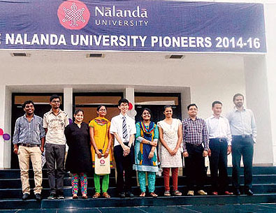 Students, teachers and officials of Nalanda University assemble outside Rajgir International Convention Centre after attending the orientation programme.